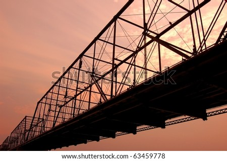 Old iron bridge at sunset