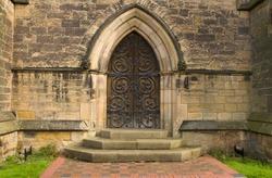 old iron decorated church door