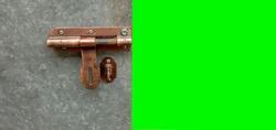 Old iron door lock with green floor
