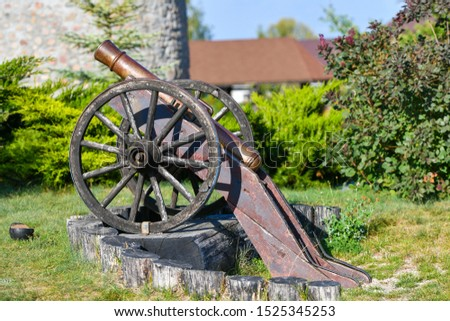 old iron gun. A cannon that shoots cores. Burning wick. Current model of an old artillery gun. naked gun, cannon on wheels, american civil war #1525345253