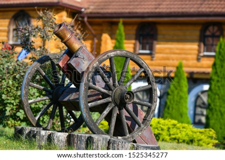 old iron gun. A cannon that shoots cores. Burning wick. Current model of an old artillery gun. naked gun, cannon on wheels, american civil war #1525345277