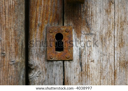 Old iron rust lock on old wooden door