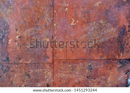 old iron wall consisting of separate pieces of metal. metal patches. Metal sheets from which the area is paint. Iron rusting.