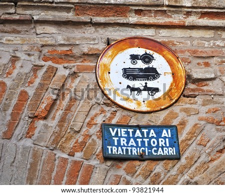 old Italian  signs on a brick wall