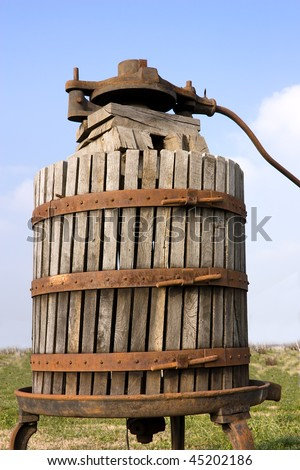 old italian wooden wine press for pressing grapes yo produce wine - stock photo