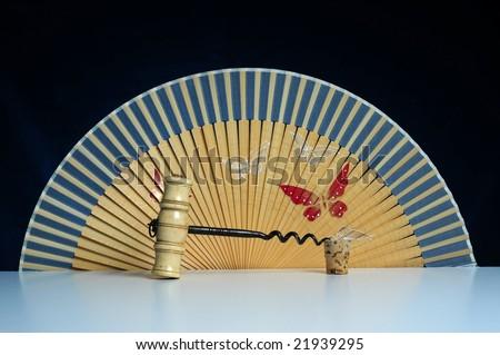 old ivory corkscrew with Oriental fan on black background