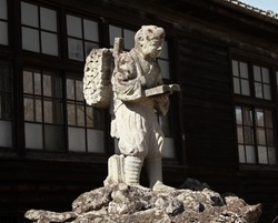 Old Japanese Sculpture in front of one of Tokyo's village museum