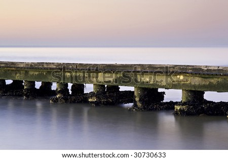 Old jetty with mussels