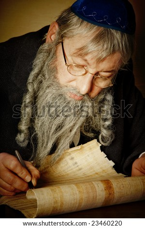 Old jewish man with beard writing on a parchment scroll