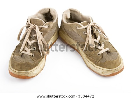 old jogging sneakers isolated on a white background