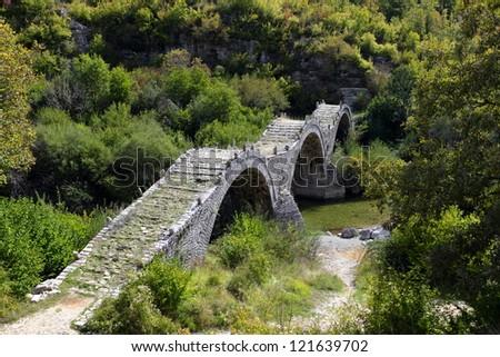 Old Kalogeriko triple arched stone bridge on Vikos canyon, Zagorohoria, Greece
