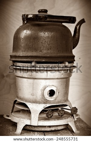 old kerosene stove with a sooty kettle