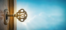 Old key in keyhole on sky background with sun ray . Concept, symbol and Idea for History, business, security, religion background.