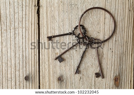 Old key on a wooden table