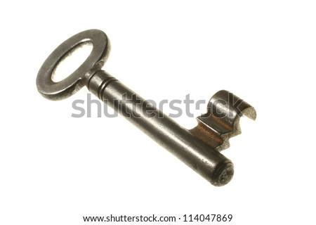 Old key on white background.