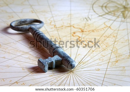 old key with patina finish on a old styled map