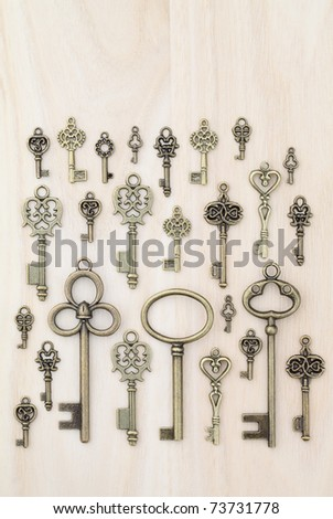 Old keys wooden background
