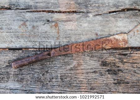 old knife on wooden floor