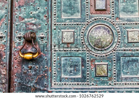 old knocker at a metal door - Shutterstock ID 1026762529