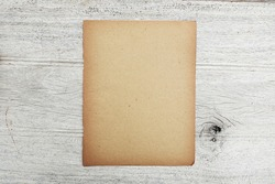 Old kraft brown vintage paper texture on grey wooden table suface