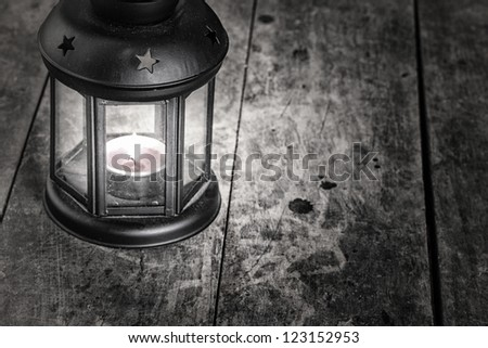 old lamp on old wooden table,grain added