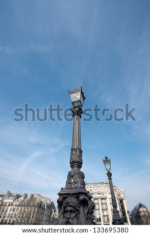 Old Lamp posts on Pont Neuf. - stock photo