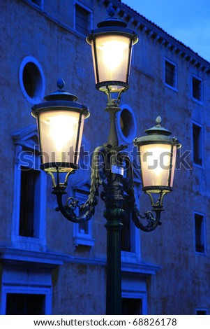 Old lamppost near palazzo