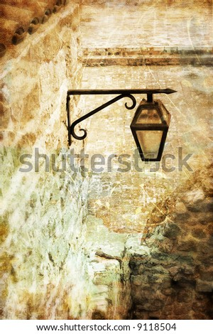 old lantern in medieval town - toned picture in retro style