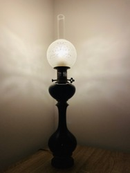 Old lantern lamp with beautiful sculpture on glass cover