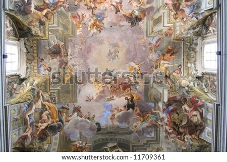 old large painting on the ceiling of a cathedral in Italy