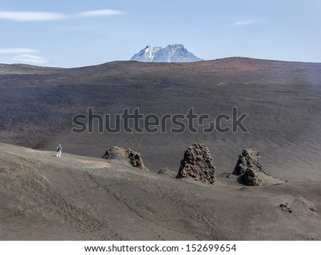 Old lava fields on the slopes of volcanoes Tolbachik, on background volcano Bolshaya Udina - Kamchatka, Russia #152699654