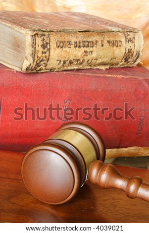 Old law books and judge hammer