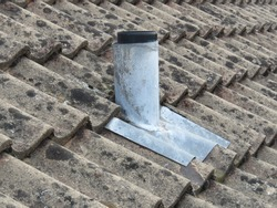 Old lead soil vent pipe on a pitched roof