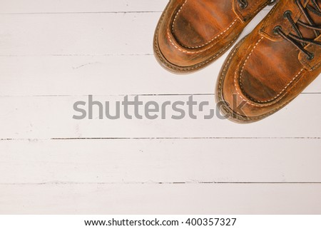 Old leather boot traditional leather style on wooden background with filter vintage style effect #400357327