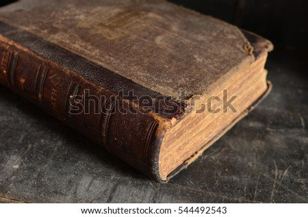 Old Leather Bound Book Laying On A Dusty Wooden Bookshelf 544492543