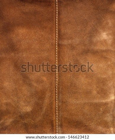 Old Leather Brown Background / Old brown used leather with center seam