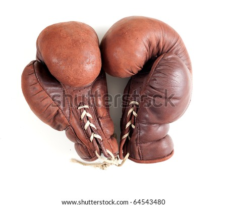 old leather brown boxing gloves on the white background