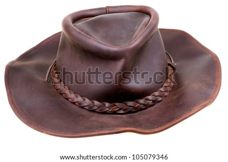 old leather brown cowboy hat isolated on white