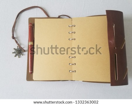Old leather journal with ropes and brown paper ideal background for travel writers or for an exploration story