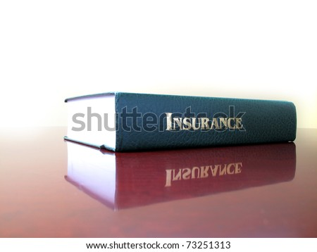 Old leather law book on the topic of insurance