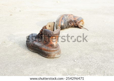 old leather safety shoes on concrete floor