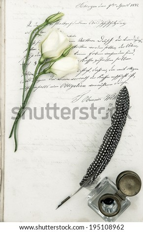 old letter, flower and antique feather pen. romantic vintage background