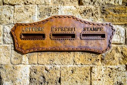 old letterbox at a door in italy - translation: letterbox, express, printed matter
