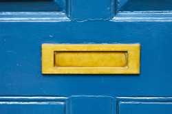 Old letterbox in the door, traditional way of delivering letters to the house, old mailbox, correspondence