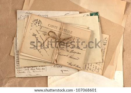old letters and french postcards. vintage background