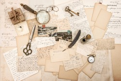 Old letters and vintage writing tools. Paper background