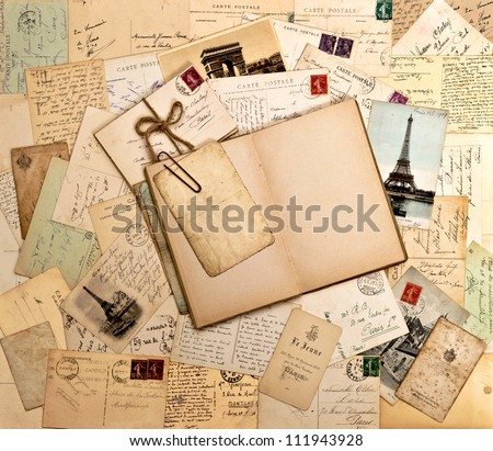 old letters, french post cards and empty open book. nostalgic vintage background - Shutterstock ID 111943928