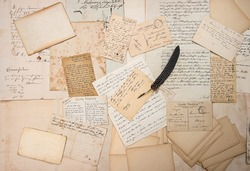 old letters, handwriting, vintage postcards and antique feather pen. nostalgic sentimental background. ephemera