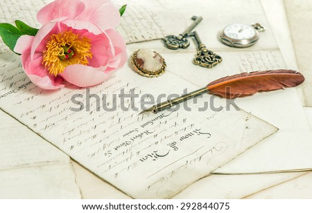 Old letters, pink rose peony flower and antique feather pen. Romantic vintage background