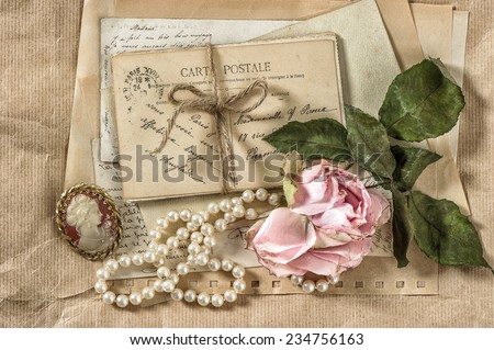 old letters, postcards and vintage things. nostalgic paper background with dry rose flower